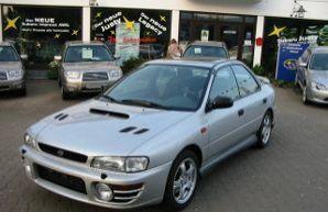 Фото 1 Subaru Impreza 4 дв. седан
