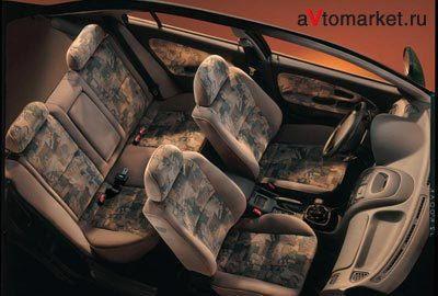Фото 4 Mitsubishi Carisma 4 дв. седан